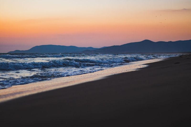 Silent beach evening Sunset Water Beauty In Nature Sea Scenics - Nature Beach Sky Nature Wave Sand