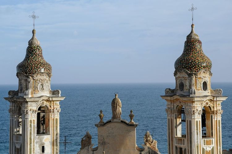 bell towers and sea Church Towers Travel Tourism Tranquility Blue Liguria,Italy Bell Towers Sea View Statue Travel Destinations Religion Architecture Sky Sculpture Outdoors No People Building Exterior Day