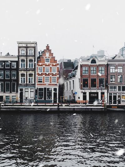 Building Exterior Architecture Built Structure Water City Sky Building Transportation No People Nature Cold Temperature River Winter Mode Of Transportation Waterfront Residential District Snowing Outdoors Nautical Vessel Day