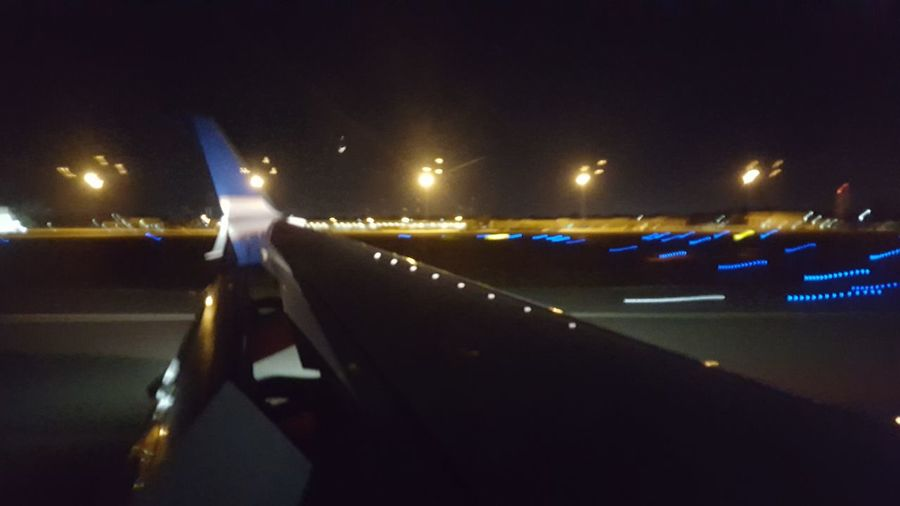 Airport Runway Wing Airplane Speed Light Photography Night Illuminated People Outdoors Adults Only Adult Ice Rink