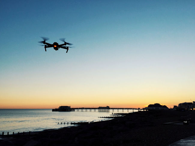 Worthing seaside Sun Sunset Gradient Sea Sea Life Seaside Sky Flying Water Transportation Clear Sky Mode Of Transportation Mid-air Air Vehicle Nature Copy Space Motion Silhouette No People Outdoors Scenics - Nature Beauty In Nature Low Angle View Drone  Dji