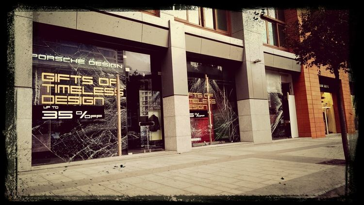 Porsche Design store with broken glass after the car Explosion which occurred in Beirut Lebanon on #friday December 27, 2013.