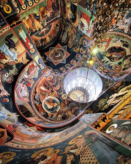 High angle view of multi colored ceiling in temple