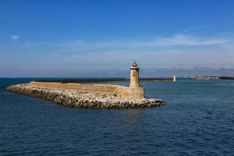 harbor entrance from livorno EyeEmNewHere Harbor Entrance Architecture Beauty In Nature Building Exterior Built Structure Cloud - Sky Day History Horizon Over Water Lighthouse Livorno Italy Nature No People Outdoors Scenics Sea Sky Tranquility Travel Destinations Water Waterfront