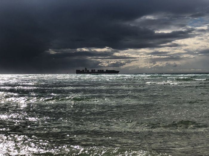 Sailing away from the storm Storm Cloud - Sky Gray Horizon Over Water Motion No People Power In Nature Scenics - Nature Sea Ship Sky Storm Cloud Water
