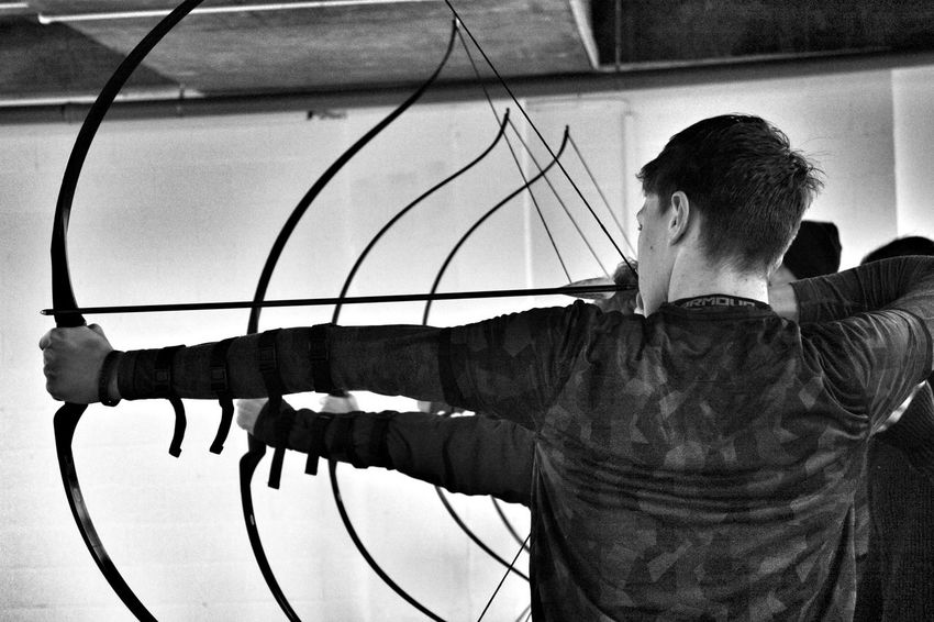 Archery Archery Bows Longbow Blackandwhite Only Men One Man Only Adults Only Adult People Young Adult Lifestyles Indoors