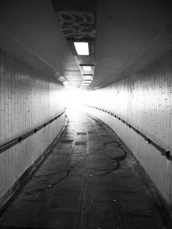 Brighton Brighton Beach Follow The Light Follow The Path Hand Rails Underpass Alleyway Architecture Blackandwhite Photography Built Structure Day Diminishing Perspective Empty Illuminated Indoors  No People Subway The Way Forward Through The Light Tile Underpasssubway Urban Decay
