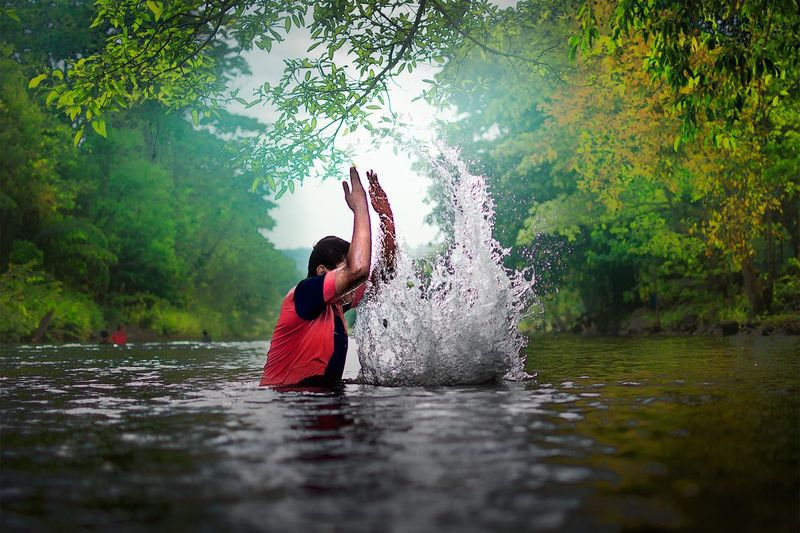Woman Jumping In Water