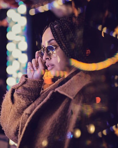 Fairground Bokeh Moments Of Happiness Illuminated One Person Leisure Activity Lifestyles Clothing Night Portrait Warm Clothing Real People Young Adult Looking Winter Young Women Adult Looking Away Selective Focus Women Headshot Waist Up Beautiful Woman Scarf Outdoors Winter Wonderland Capturing Freedom Capture Tomorrow Humanity Meets Technology