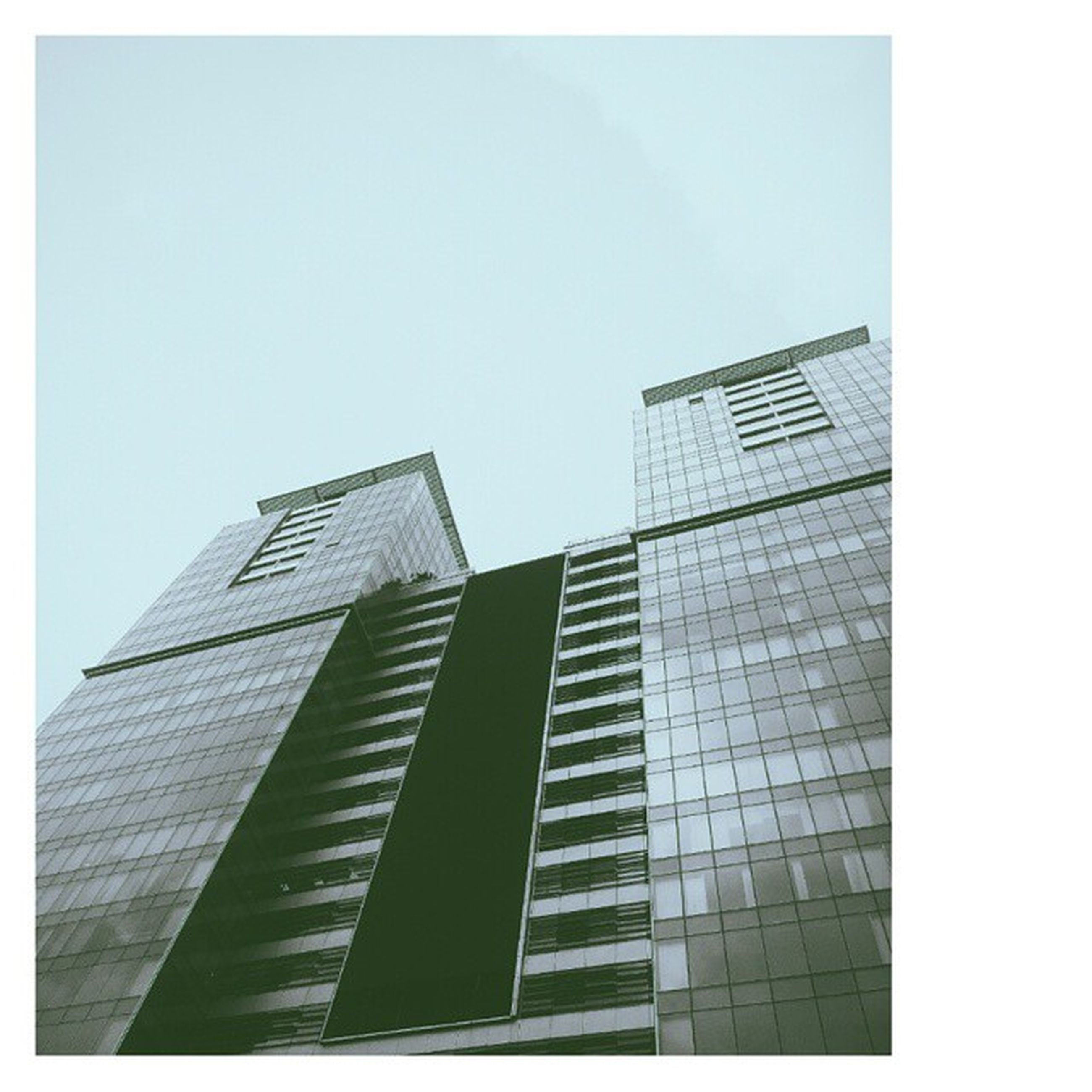 architecture, building exterior, built structure, low angle view, clear sky, office building, tall - high, skyscraper, modern, tower, transfer print, city, auto post production filter, building, glass - material, tall, sky, copy space, day, window