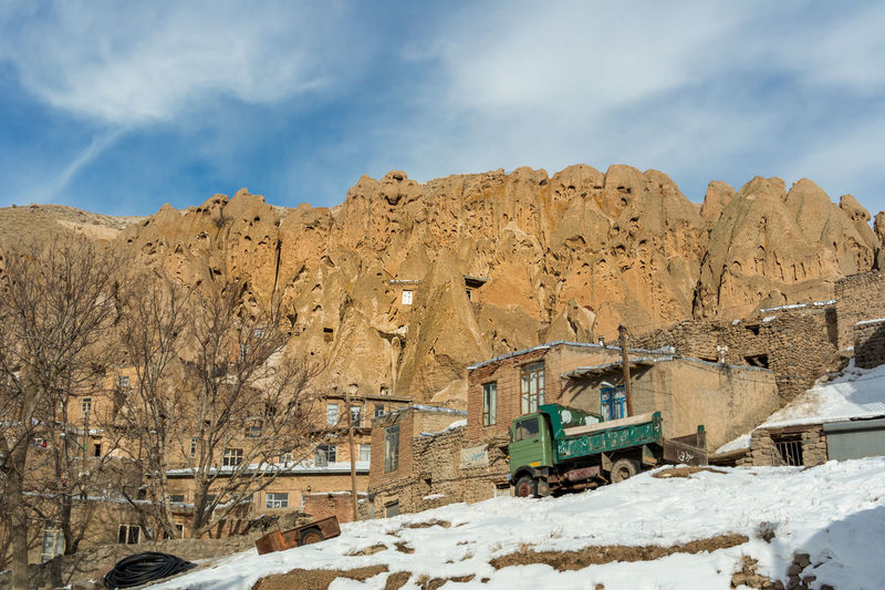 The small village of Kandovan near to Tabriz, Northern Iran. Also known as Irans Cappadocia due to its unique rock formations that locals and caved out and used as their homes for hundreds of years. Cappadocia Kandovan Cloud - Sky Cold Temperature Day Environment Formation Industry Inhabitants Inhabited Land Landscape Mode Of Transportation Mountain Mountain Range Nature No People Outdoors Rock Scenics - Nature Sky Snow Transportation Winter