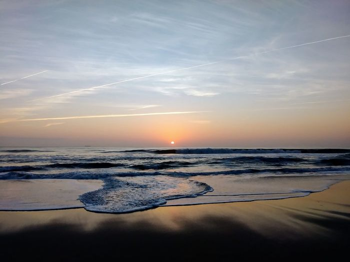 seaside sunrise Ocean View Oceanside Beach Beachphotography Beach Life Water Sea Blue Sunlight Sun Calm Seascape Dramatic Sky Tide Moody Sky Sunrise Sunbeam Ocean Atmospheric Mood Romantic Sky Coast Low Tide EyeEmNewHere It's About The Journey My Best Photo