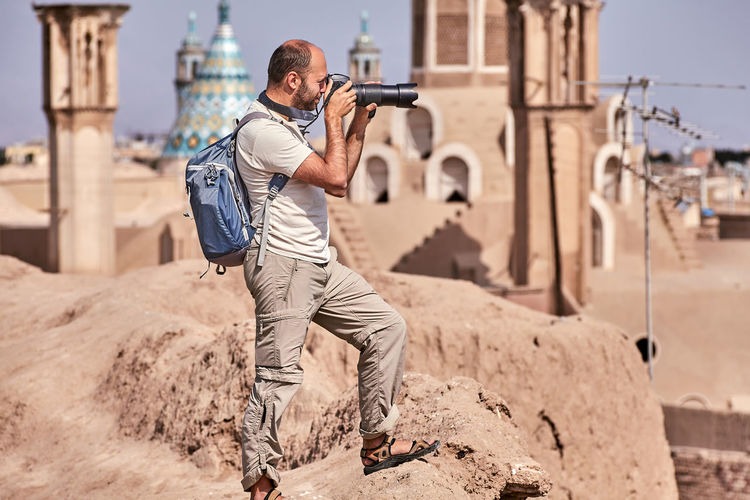 Man with camera at historic place
