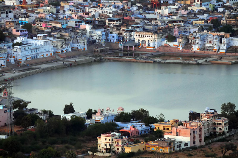 High angle view of lake amidst houses in pushkar