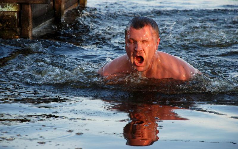 Portrait of man swimming in water