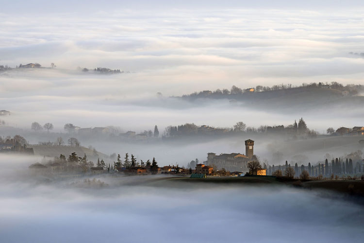 Scenic view of levizzano castle with sea of clouds during foggy weather