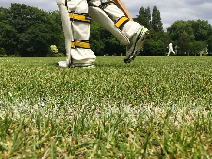 Guys are playing cricket in the Battersea park in London Uk Crickets Battersea Park London Playing Cricket Cricket In The Park Human Leg Low Section Grass Day Growth Outdoors Soccer Nature Tree One Person Only Men Soccer Field Soccer Shoe Adult Adults Only People Sport Battersea Park Cricket Body Part Grass Real People Shoe