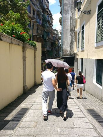 Couple on the street Couple Asian  Couple City Men Women Shadow Full Length Sunlight Togetherness Architecture Building Exterior Built Structure Pedestrian City Street Street Scene Sidewalk Walking Friend Summer In The City A New Beginning Human Connection