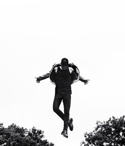 - Airborne Bnwphotography Visual Creativity Bnw_captures Nycphotographer Creative EyeEm Best Shots eyeemphoto Travcimages Eye4photography  EyeEm Gallery EyeEm Sky Full Length Low Angle View Clear Sky Plant One Person Mid-air Jumping Leisure Activity