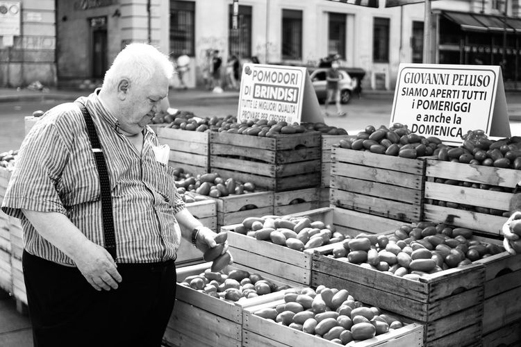 Man for sale at market stall