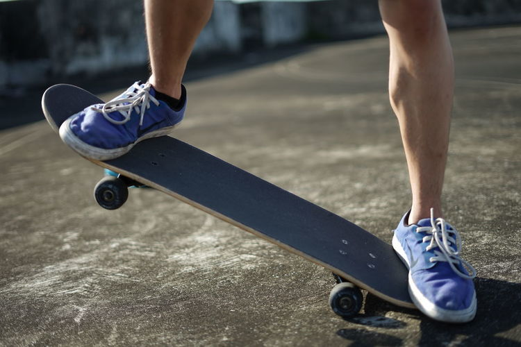 Balance Body Part Day Exercising Healthy Lifestyle Human Body Part Human Foot Human Leg Human Limb Leisure Activity Lifestyles Low Section Motion One Person Shoe Skateboard Skill  Sport Sports Equipment Sports Shoe Vitality