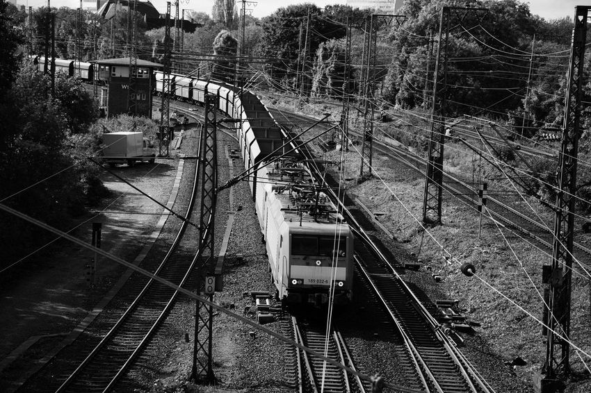 Architecture Built Structure Cable Connection Day High Angle View Mode Of Transport Nature No People Outdoors Public Transportation Rail Transportation Railroad Track Railway Track Train - Vehicle Transportation Tree Water