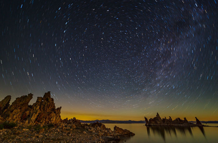 Dancing stars over Mono Lake The stars danced around Polaris over the calm lake as the moon started rising. Mono Lake, California Astronomy Astrophotography Beauty In Nature Big Dipper California Dark Lake Landscape Landscape_photography Mono Lake Nature Night Night Sky No People Peaceful Polaris Reflections Rock Formations Sky South Tufa Space Star - Space Star Trails Tranquility Water