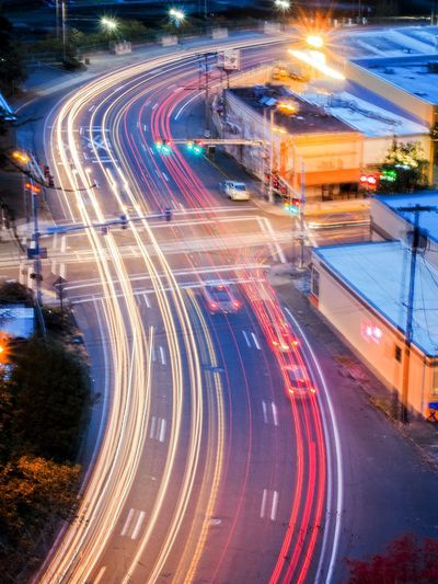 Activity Architecture Blurred Motion Car City City Life City Street Dusk High Angle View High Street Illuminated Light Trail Long Exposure Modern Motion Night No People Outdoors Road Rush Hour Speed Street Street Light Traffic Transportation