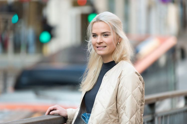 Happy young woman portrait in city EyeEm Selects One Person Happiness Women Smiling Architecture Adult Portrait Clothing City Emotion Hair Lifestyles Blond Hair Young Adult City Life Casual Clothing Looking Hairstyle Warm Clothing