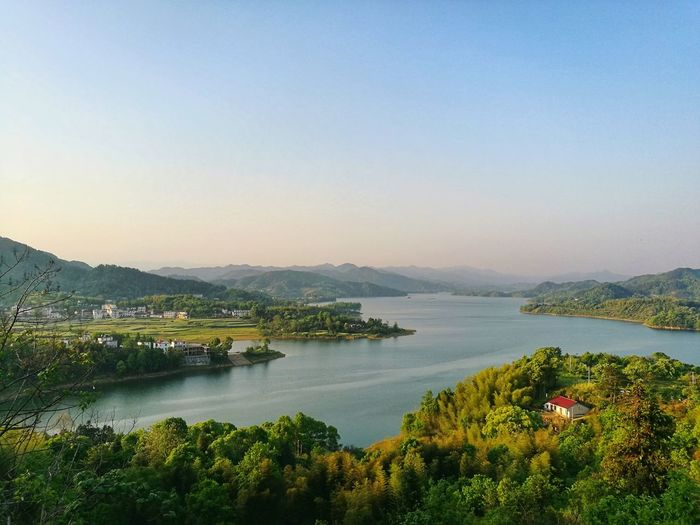 Anhui, China, Countryside On The Road Lake Landscape Water Mountain Sky Tree Outdoors Tranquility Nature Clear Sky Blue Scenics Travel Destinations Beauty In Nature Sunset No People Mountain Range Forest Day Vacations China Beauty China Photos China In My Eyes China View China Photos Relaxing Landscape