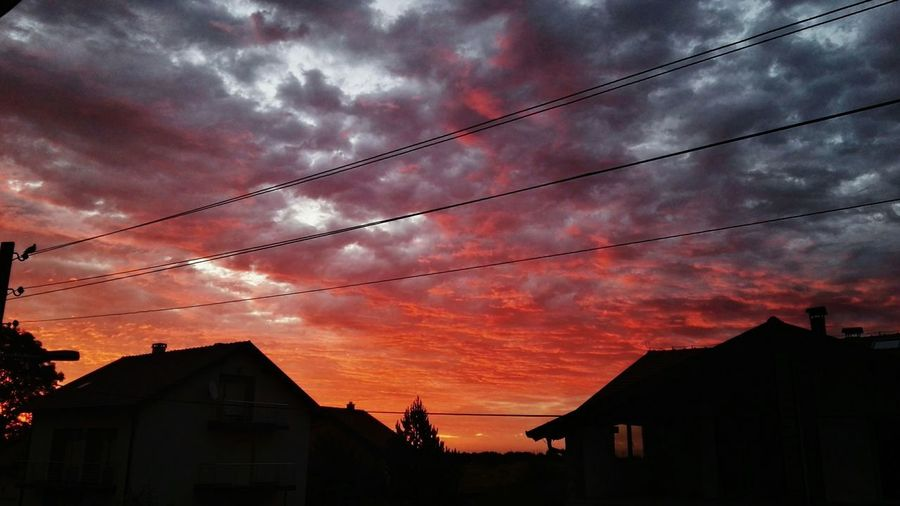 Dramatic Sky Extreme Weather Weather Sky Cable Building Exterior Outdoors No People Cloud - Sky Silhouette Silhouettes Built Structure Architecture Nature Beauty In Nature Scenics Red Colors Colorful Capture The Moment Sunrise Day EyeEm Best Shots - Nature EyeEm Nature Lover Tree