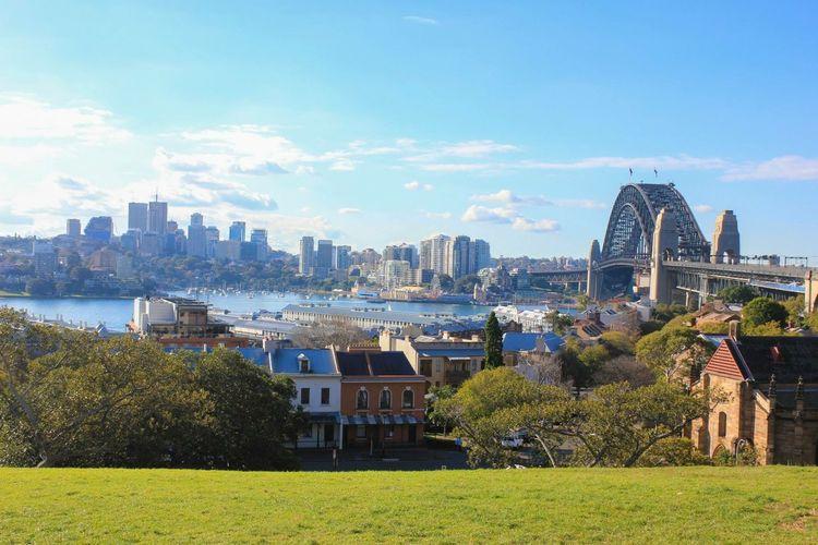 Sydney Harbor Bridge On Bay Of Water In City Against Sky