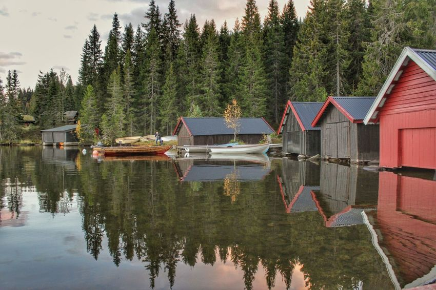 Reflection Water Tree Lake Built Structure Building Exterior Tranquility Architecture Day Nature Outdoors No People Travel Destinations Nautical Vessel Mountain Beauty In Nature Sky Boat Boathouse