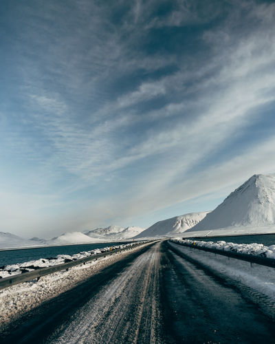 Cloud - Sky Sky Cold Temperature Snow Winter Road Transportation Scenics - Nature The Way Forward Direction Mountain Beauty In Nature Environment Tranquil Scene Nature No People Tranquility Day Non-urban Scene Diminishing Perspective Snowcapped Mountain