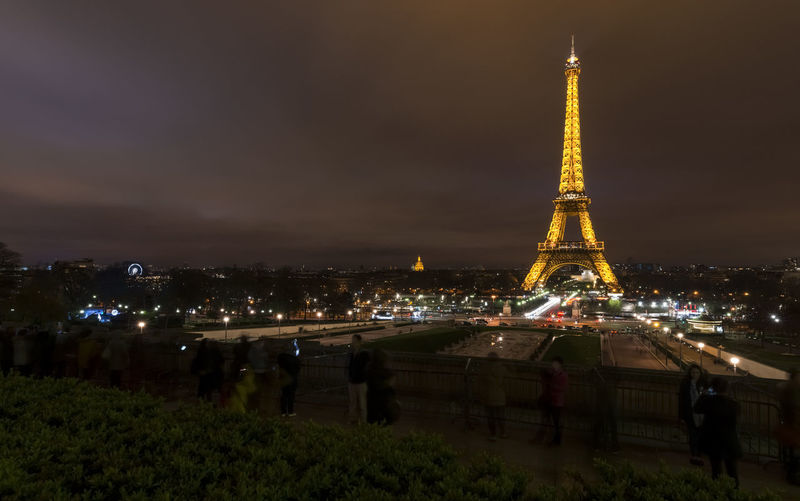 Illuminated Eiffel Tower at glowing at night Eiffel Tower Built Structure Night Glowing Landmark Monument Travel Destinations Famous Place Panorama Distant Tall - High Night Sky No People Architectural Feature Tower Illuminated Extreme Long Shot City Urban