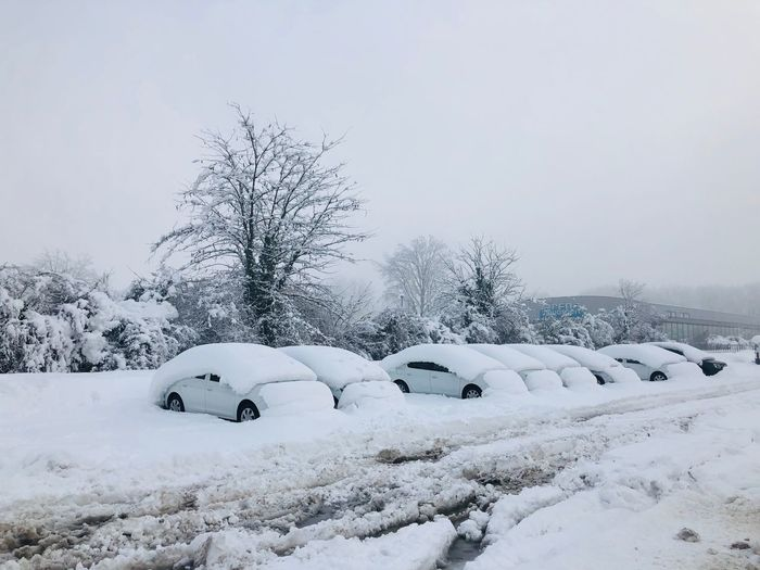 Extreme weather conditions - cars covered in snow during winter