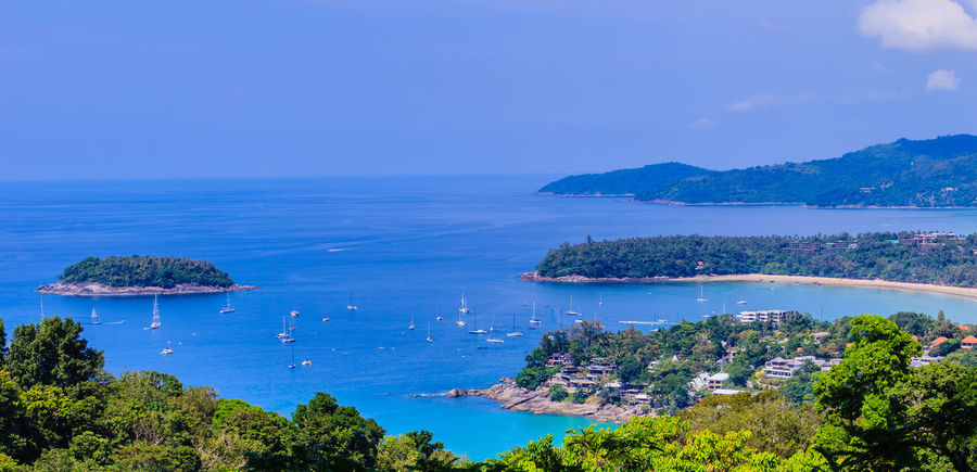 Beautiful landscape of turquoise ocean waves with boats, coastline and blue sky background from high aerial view point of Kata and Karon beaches in Phuket Thailand. Aerial View Of Beach Coastline Coastline Landscape Coastline Nature Water Karon Beach, Phuket Kata Beach Kata Beach,Phuket Thailand Kata Beach Phuket, Thai Seashore Aerial View Beach Beauty In Nature Blue Clear Sky Coastline Beauty Coastline Sky Day High Angle View Horizon Over Water Karon Karon Beach Karon View Point Kata Landscape Nature Nautical Vessel No People Ocean Wave. Ocean Waves Ocean Waves Hits The Rock Outdoors Scenics Sea Seascape Seaside Sky Tranquil Scene Tranquility Transportation Tree Turquoise Turquoise Sea Water