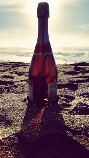 Beach Sea Water Horizon Over Water No People Liquid Cloud - Sky Sand Sunset Sky Outdoors Day Close-up Scenics Daytime Photography Sunlight Champagne Glass Bottle Alcohol Silhouette