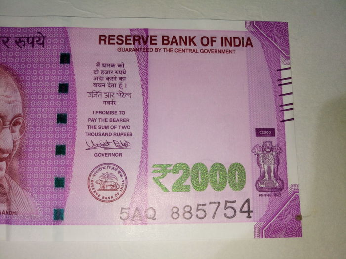 Indian two thousand rupee note 2000 Banknote Business Close-up Currency Indian Finance Finance And Economy Graphical User Interface Indian Culture  Indian Currency Indian Two Thousand Rupee Note Indoors  New No People Paper Currency Pink Color Savings Success Text Two Thousand Rupee Note Wealth