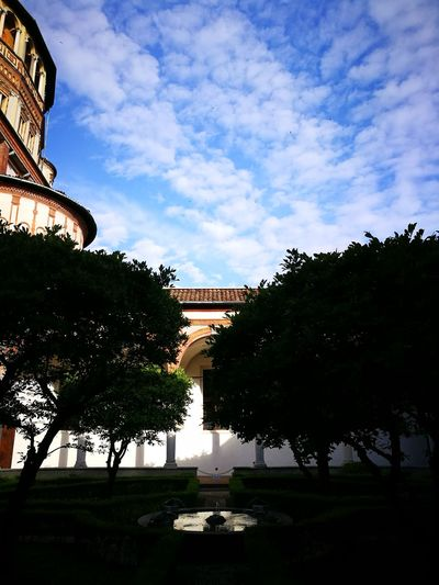 Cloister garden Old Structure Still In Use Today History Santa Maria Delle Grazie Italy Milano Corso Magenta Milan,Italy Clouds And Sky Morning Light Morning Sky Cathedral Chruch Cloister Garden Trees And Sky Garden Fountain