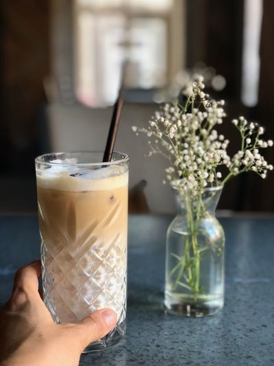 Cold brew love Glass Refreshment Drink Food And Drink Drinking Glass Household Equipment Hand Human Hand Flower Focus On Foreground Flowering Plant Plant Freshness Table The Foodie - 2019 EyeEm Awards The Minimalist - 2019 EyeEm Awards The Mobile Photographer - 2019 EyeEm Awards My Best Photo