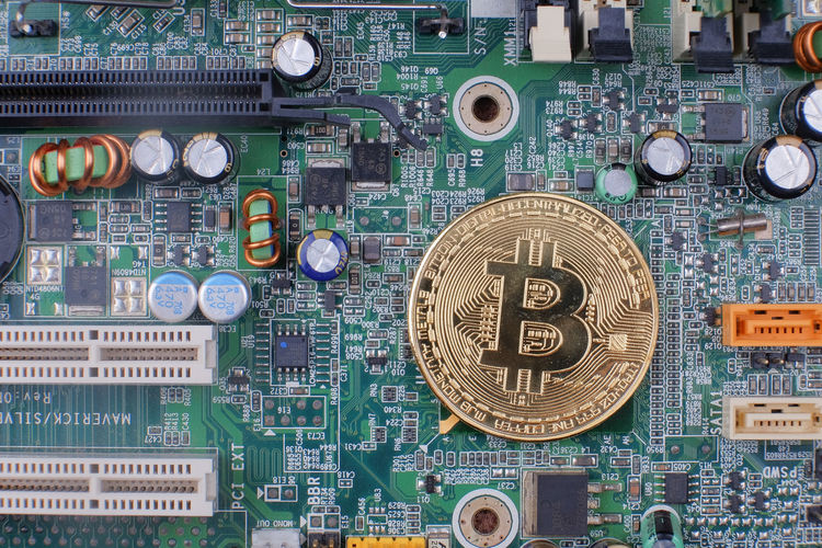Directly above shot of bitcoin on circuit board