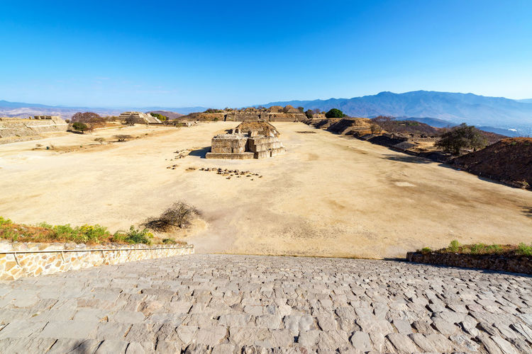 Wide angle view of the ancient ruins of Monte Alban in Oaxaca, Mexico Architecture Cityscape Hills Mayan Mayan Ruins Mexico Oaxaca Oaxaca México  Pyramid Rock Ruins Temples Travel Building Maya Monte Alban Mountain Old Platforms Rocks Ruin Stone Stones Temple Tourism