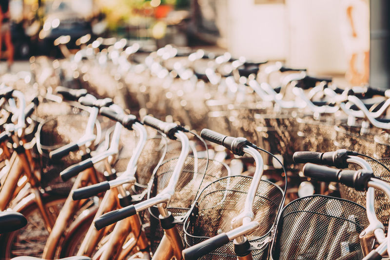 Close-up of bicycles parked side by side in city