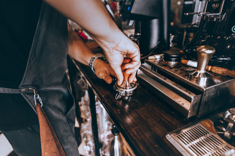 coffee Human Body Part Real People Hand One Person Indoors  Working Food And Drink Holding Women Selective Focus Body Part Cafe Drink Occupation Coffee Maker Adult Refreshment Midsection Coffee Shop Finger Human Hand Coffee Coffee - Drink Coffee Cup Coffee Time Coffee Break