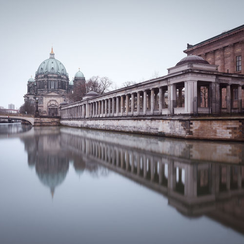 Berlin cathedral by spree river against sky in city