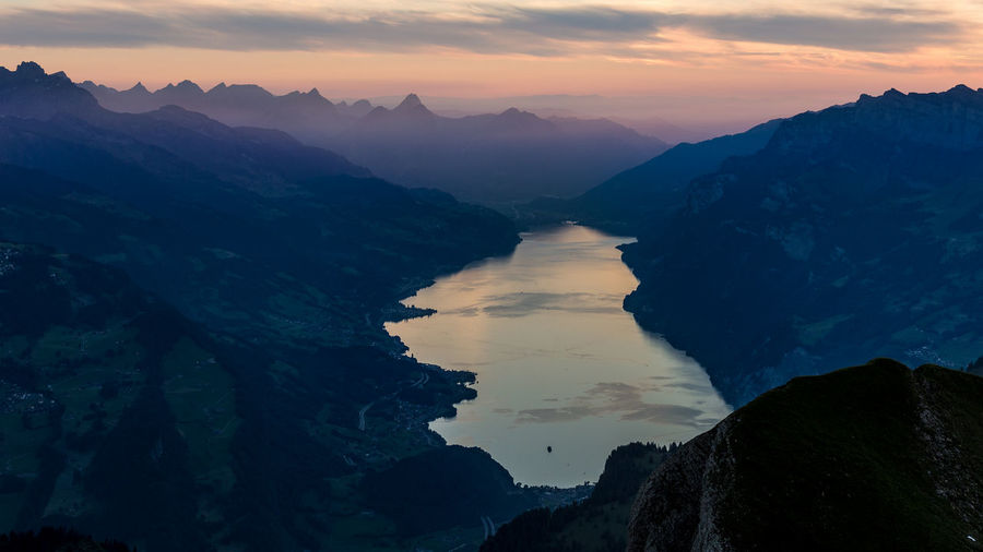 Moody Sky Beauty In Nature Cloud - Sky Formation Idyllic Mountain Mountain Range Nature No People Non-urban Scene Outdoors Rock Rock - Object Scenics - Nature Silhouette Sky Solid Sunset Switzerland Tranquil Scene Tranquility Walensee Water