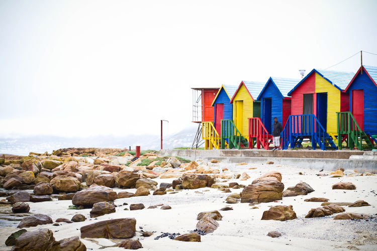 Colorful beach huts by the Saint James tidal pool Outdoors Bright Sand Rock - Object Solid Rock Sea Water Multi Colored Land Sky Beach Beach Huts Beach Hut Tidal Pool Saint James South Africa Nature Architecture Built Structure Building Exterior