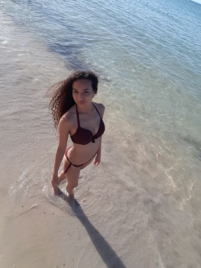 Beach Bikini Summer One Person Sand Sea Vacations Long Hair Girls Looking At Camera Modelgirl Ash Only Women Beauty In Nature Model Shoot Model Model Pose Model Photography Punta Cana, Dominican Republic Curly Hair Women Standing Sunlight Day Young Women