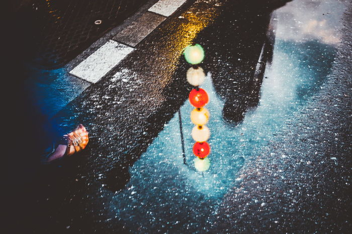 HUAWEI Photo Award: After Dark City Day High Angle View Leisure Activity Low Section Nature One Person Outdoors Real People Road Street Sunlight Toy Water Wet